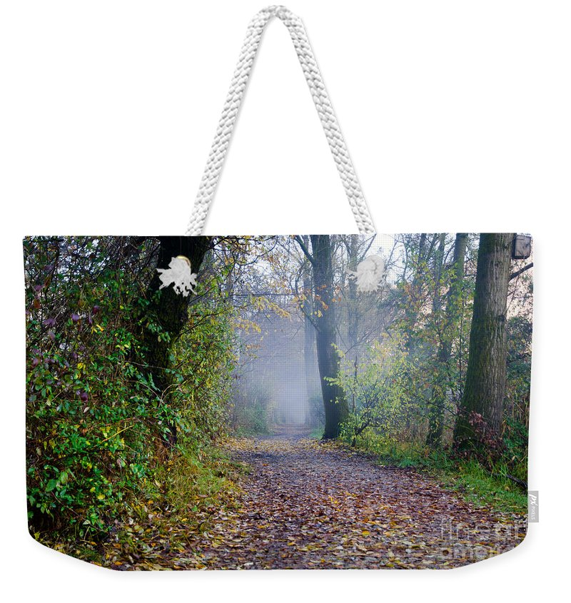 Road Weekender Tote Bag featuring the photograph Foggy Road by Mats Silvan