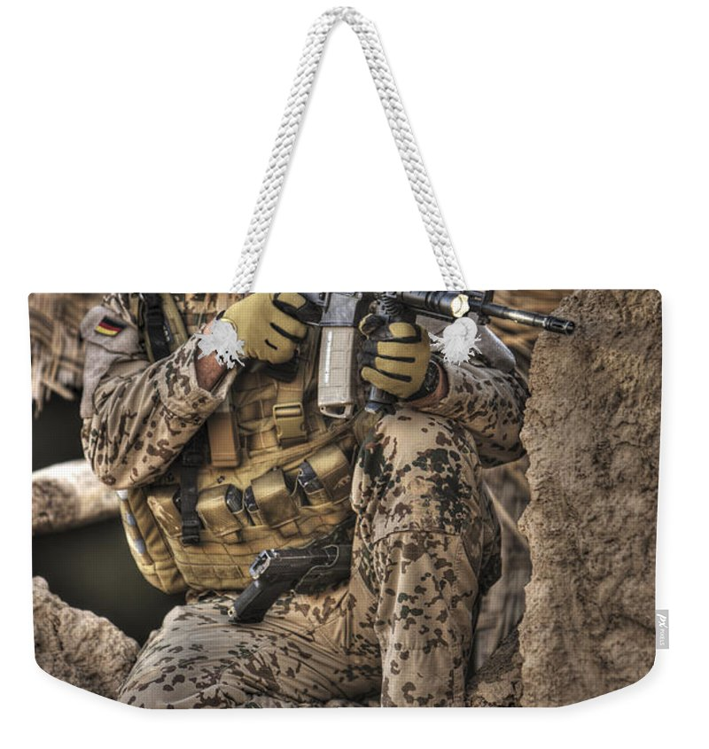 Aiming Weekender Tote Bag featuring the photograph Hdr Image Of A German Army Soldier by Terry Moore