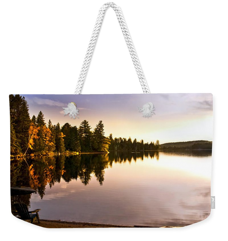 Canoe Weekender Tote Bag featuring the photograph Lake Sunset With Canoe On Beach by Elena Elisseeva