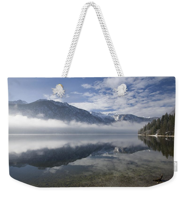 Bohinj Weekender Tote Bag featuring the photograph mist burning off Lake Bohinj by Ian Middleton