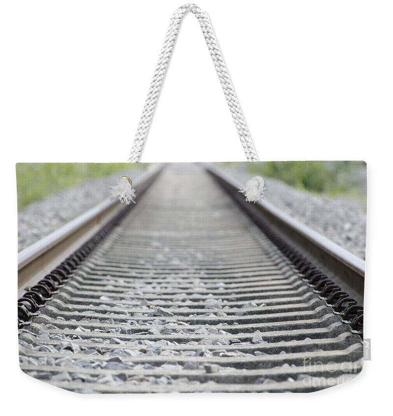 Railroad Tracks Weekender Tote Bag featuring the photograph Railroad Tracks by Mats Silvan