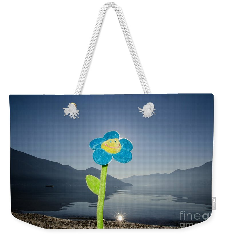 Smile Flower Weekender Tote Bag featuring the photograph Smile Flower by Mats Silvan