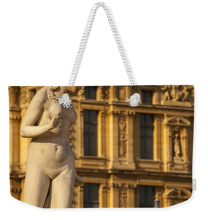 Architecture Weekender Tote Bag featuring the photograph Statue Below Musee Du Louvre by Brian Jannsen