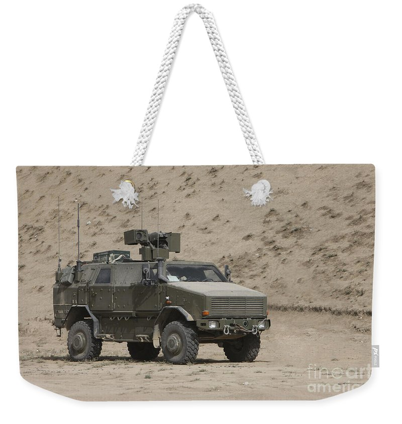 No People Weekender Tote Bag featuring the photograph The German Army Atf Dingo Armored by Terry Moore