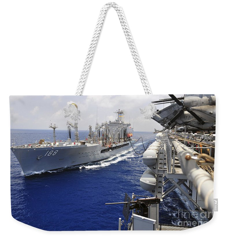Amphibious Assault Ships Weekender Tote Bag featuring the photograph The Military Sealift Command Fleet by Stocktrek Images