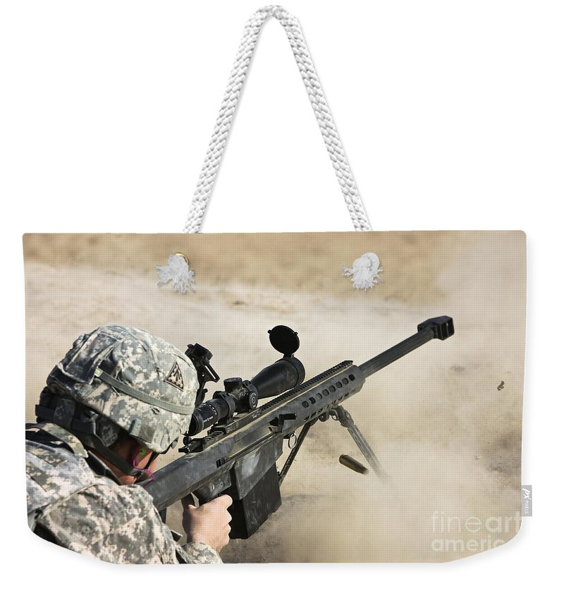 Sniper Weekender Tote Bag featuring the photograph U.s. Army Soldier Fires A Barrett M82a1 by Terry Moore