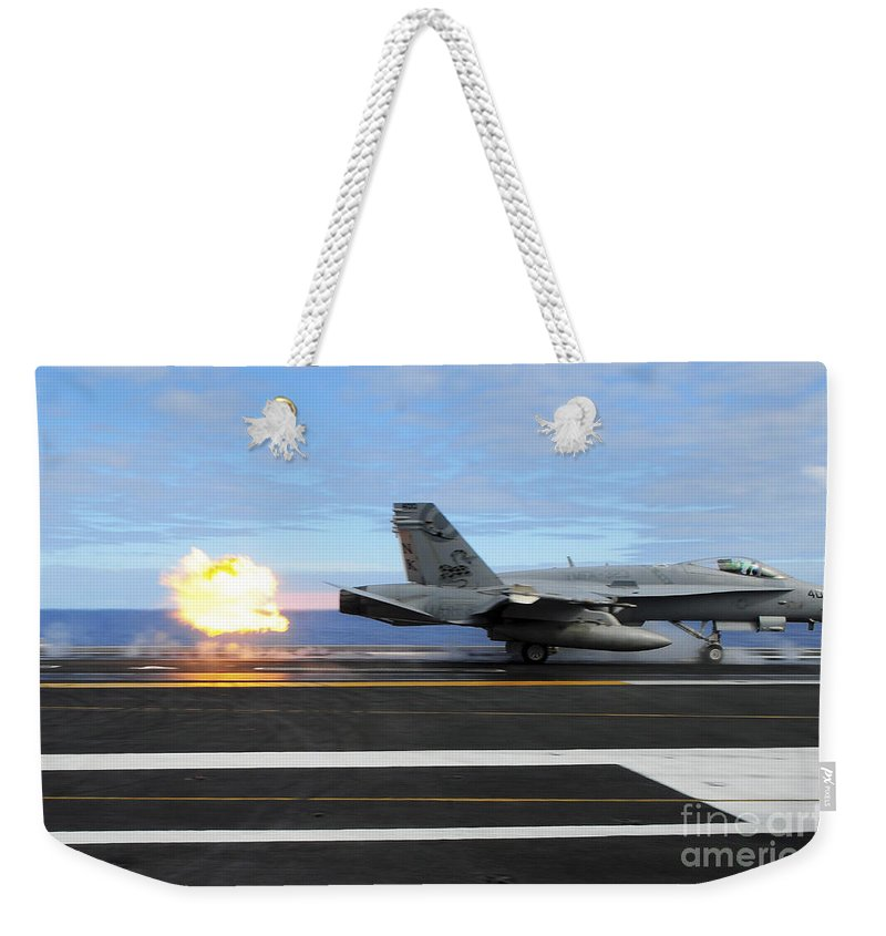 Flight Operations Weekender Tote Bag featuring the photograph An Fa-18c Hornet Launches by Stocktrek Images