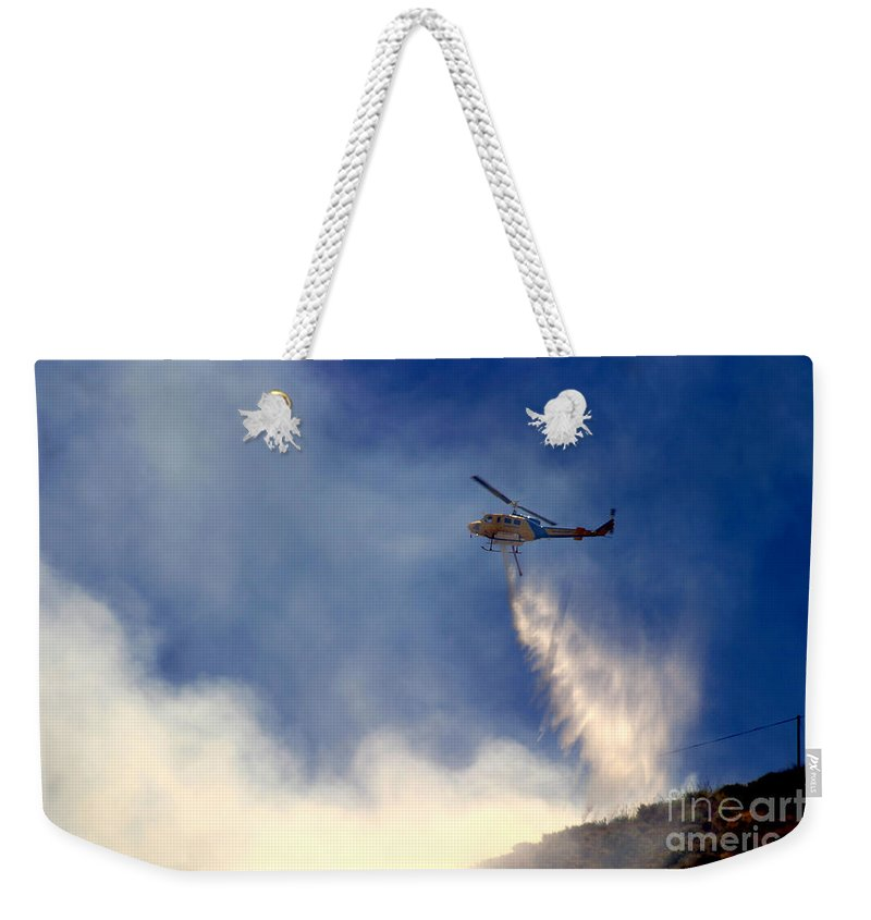 Ash Weekender Tote Bag featuring the photograph Barnett Fire by Henrik Lehnerer
