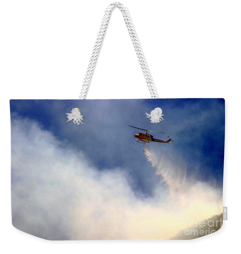 Ash Weekender Tote Bag featuring the photograph Barnett Fire by Henrik Lehnerer