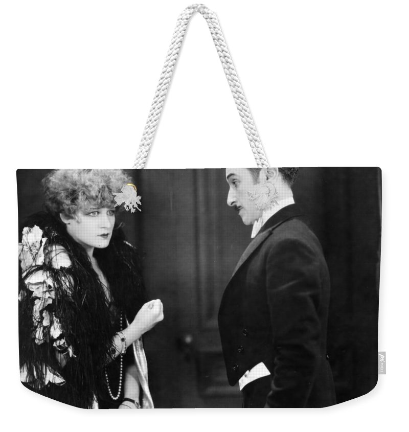 -ecq- Weekender Tote Bag featuring the photograph Silent Still: Man & Woman by Granger