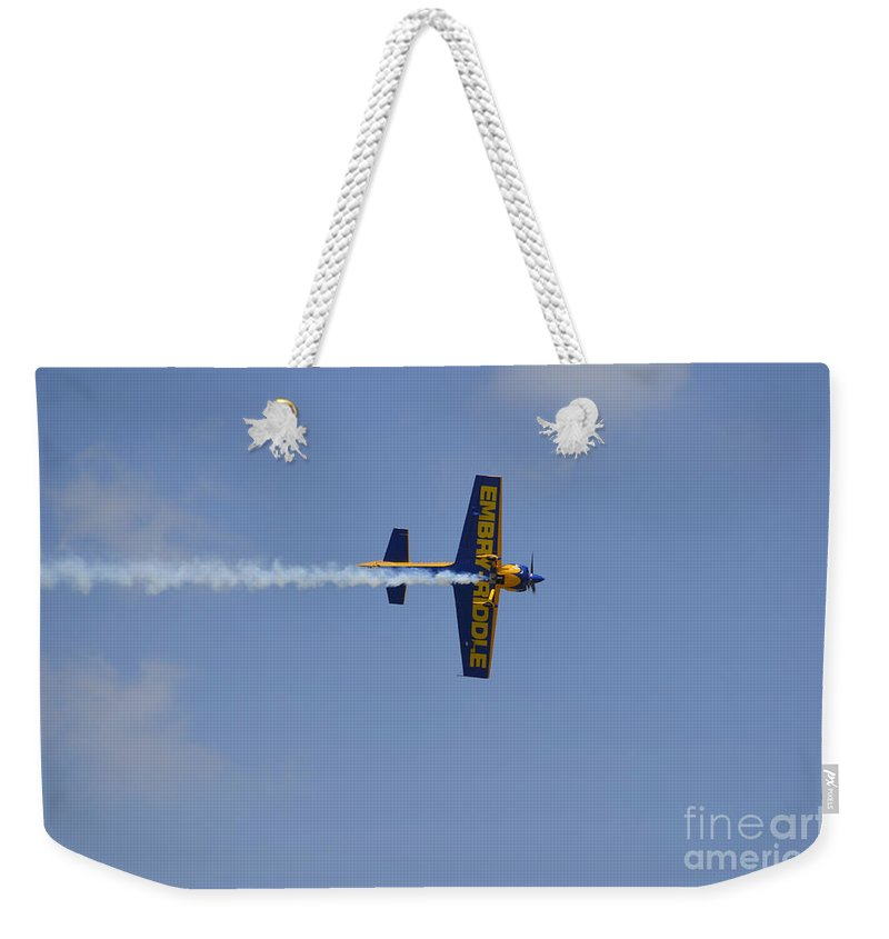 Florida Weekender Tote Bag featuring the photograph A Mudry Cap-231ex Aerobatic Aircraft by Stocktrek Images