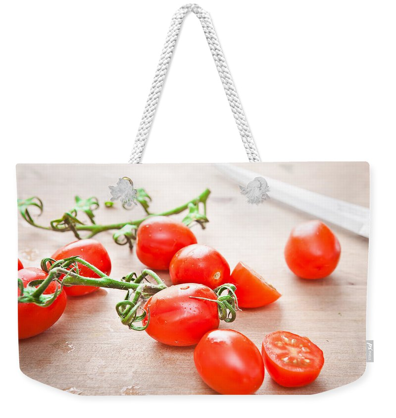 Blade Weekender Tote Bag featuring the photograph Cherry Tomatoes by Tom Gowanlock