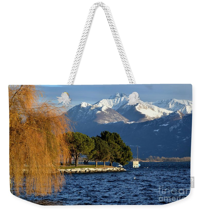 Lake Weekender Tote Bag featuring the photograph Snow-capped Mountain by Mats Silvan