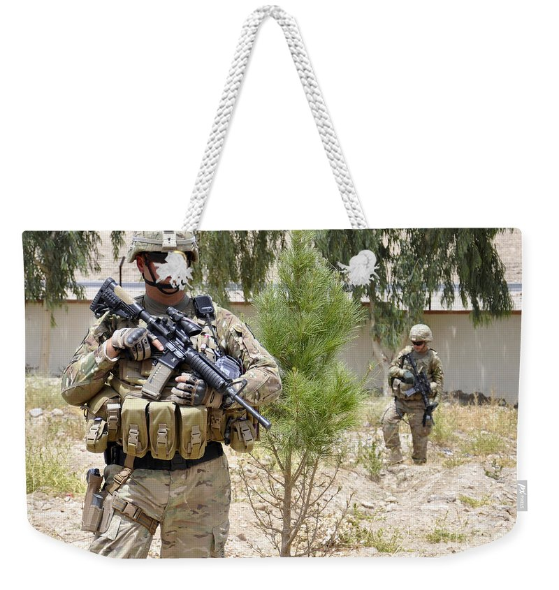 Operation Enduring Freedom Weekender Tote Bag featuring the photograph U.s. Army Soldier Stands Guard by Stocktrek Images