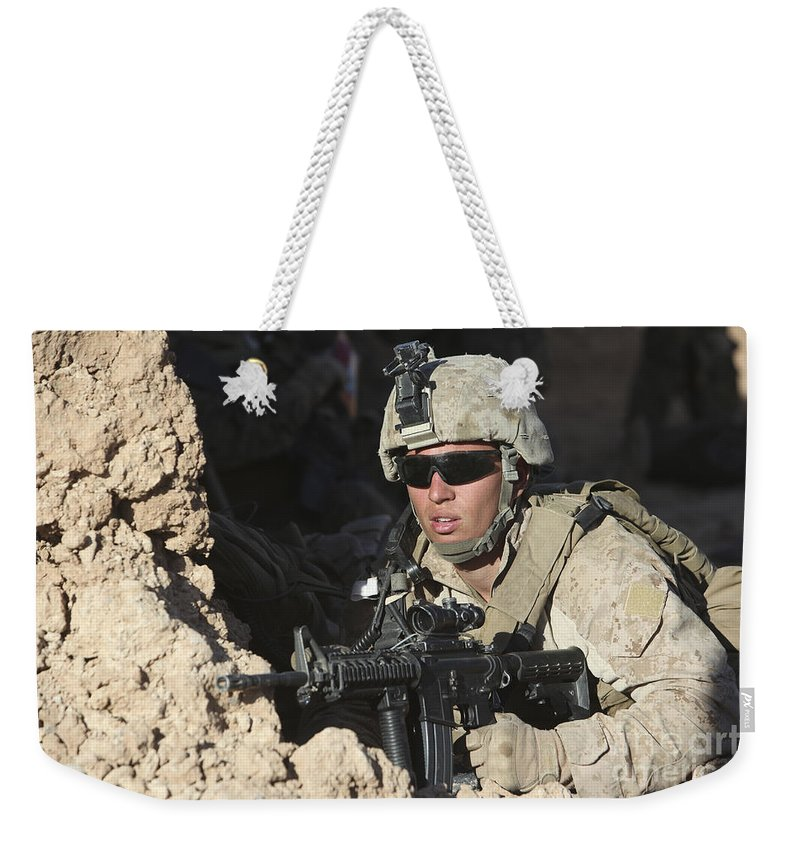 Military Weekender Tote Bag featuring the photograph U.s. Marine Provides Security by Stocktrek Images