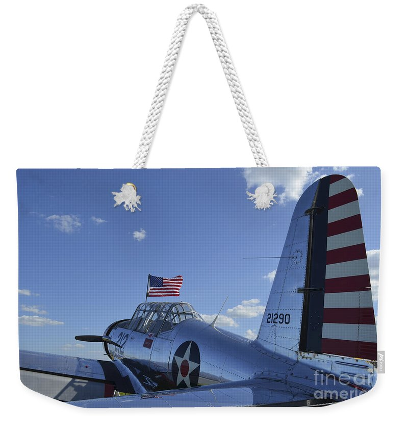 Aviation Weekender Tote Bag featuring the photograph A Bt-13 Valiant Trainer Aircraft by Stocktrek Images