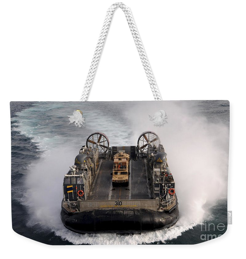 Lcac Weekender Tote Bag featuring the photograph A Landing Craft Air Cushion Transits by Stocktrek Images