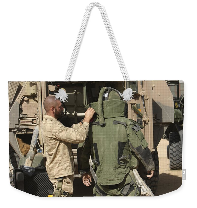 Afghanistan Weekender Tote Bag featuring the photograph A U.s. Marine Gets Suited by Terry Moore