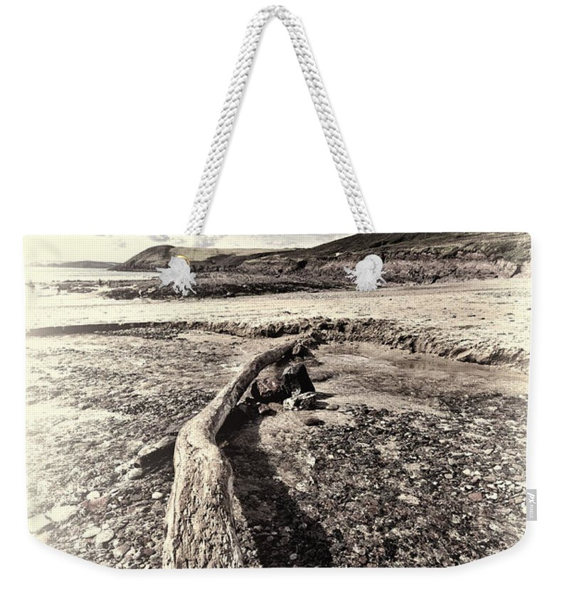 Driftwood. Manorbier Beach Weekender Tote Bag featuring the photograph Driftwood by Steve Purnell
