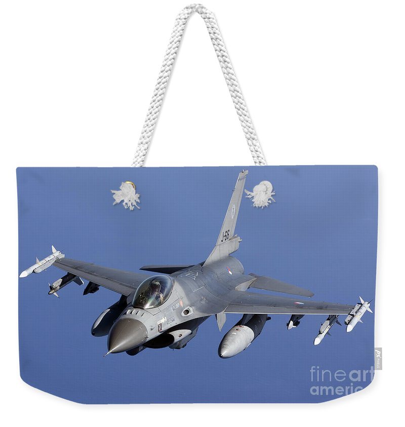 Aim-120 Weekender Tote Bag featuring the photograph Dutch F-16am During A Combat Air Patrol by Gert Kromhout