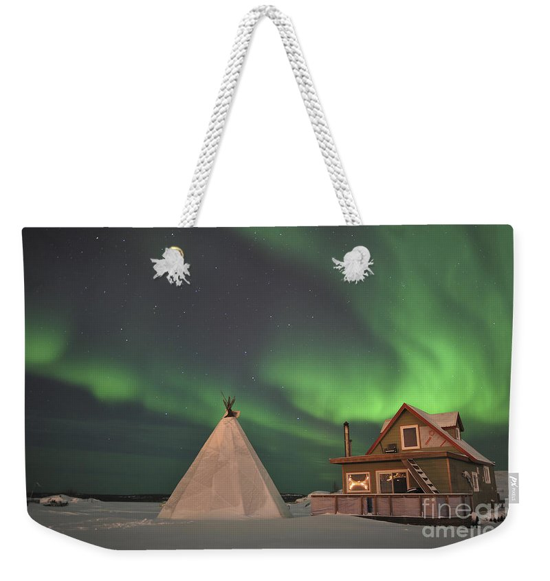 Yellowknife Weekender Tote Bag featuring the photograph Northern Lights Above Village by Jiri Hermann
