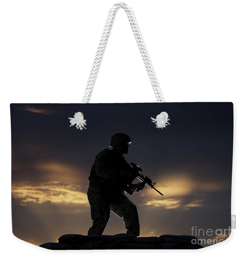 Vigilant Weekender Tote Bag featuring the photograph Partially Silhouetted U.s. Marine by Terry Moore
