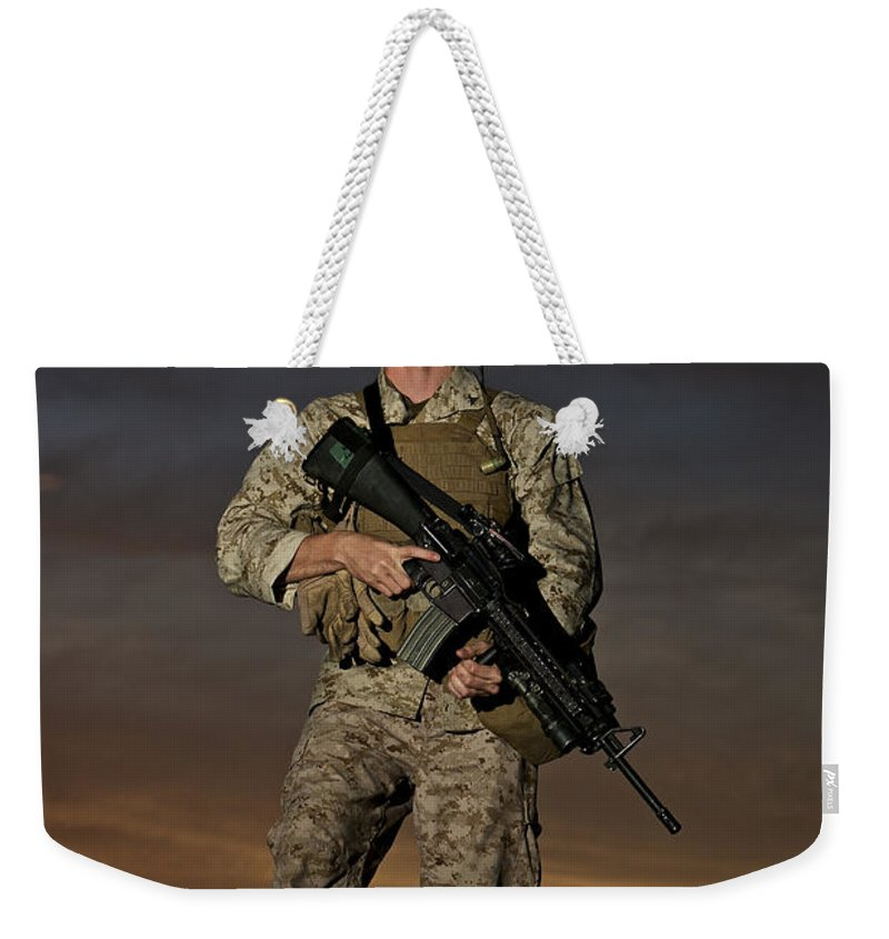 Helmet Weekender Tote Bag featuring the photograph Portrait Of A U.s. Marine In Uniform by Terry Moore