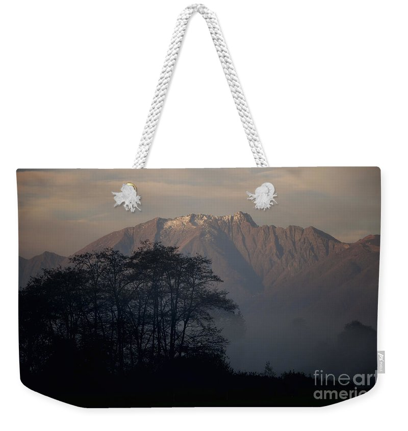 Trees Weekender Tote Bag featuring the photograph Snow-capped Mountain by Mats Silvan