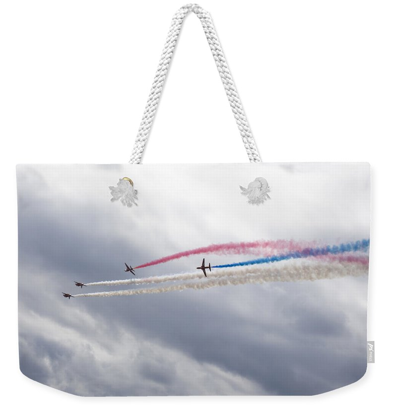 Red Weekender Tote Bag featuring the photograph The Red Arrows by Ian Middleton