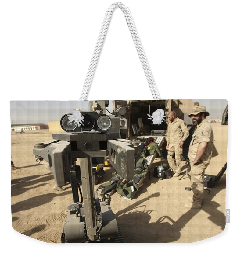 German Army Weekender Tote Bag featuring the photograph The Teodor Heavy-duty Bomb Disposal by Terry Moore