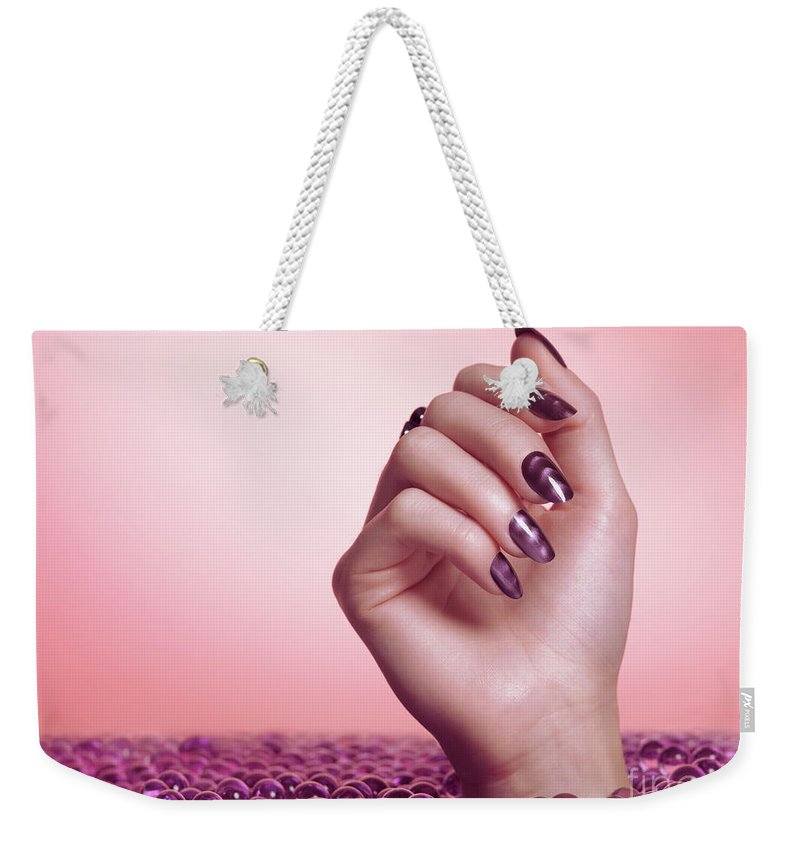 Manicure Weekender Tote Bag featuring the photograph Woman Hand With Purple Nail Polish by Oleksiy Maksymenko