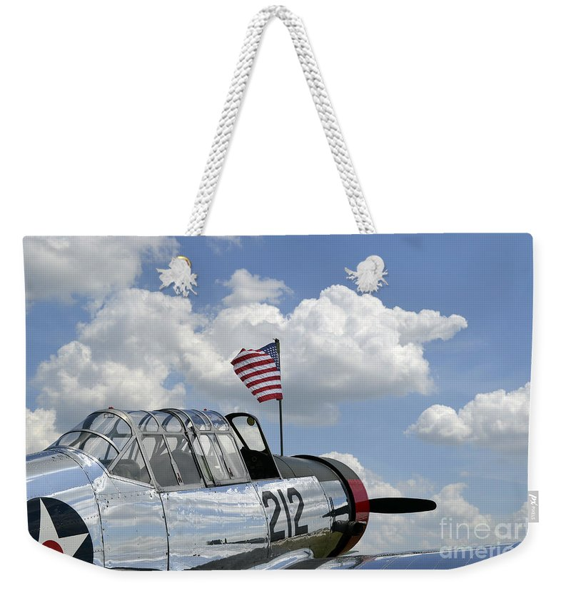 Symbolic Weekender Tote Bag featuring the photograph A Bt-13 Valiant Trainer Aircraft by Stocktrek Images