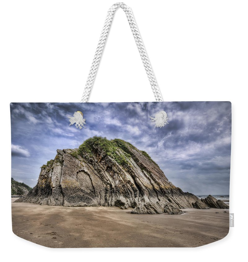 Goscar Rock Tenby Weekender Tote Bag featuring the photograph Goscar Rock Tenby by Steve Purnell