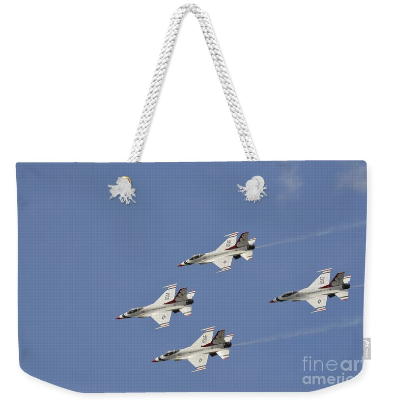 Team Weekender Tote Bag featuring the photograph The U.s. Air Force Thunderbirds Fly by Stocktrek Images