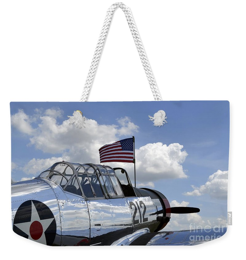 Vultee Aircraft Weekender Tote Bag featuring the photograph A Bt-13 Valiant Trainer Aircraft by Stocktrek Images