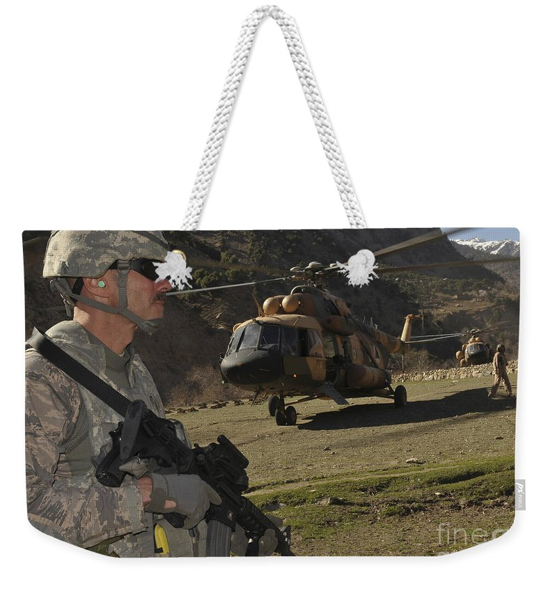 Security Weekender Tote Bag featuring the photograph A Soldier Provides Security by Stocktrek Images