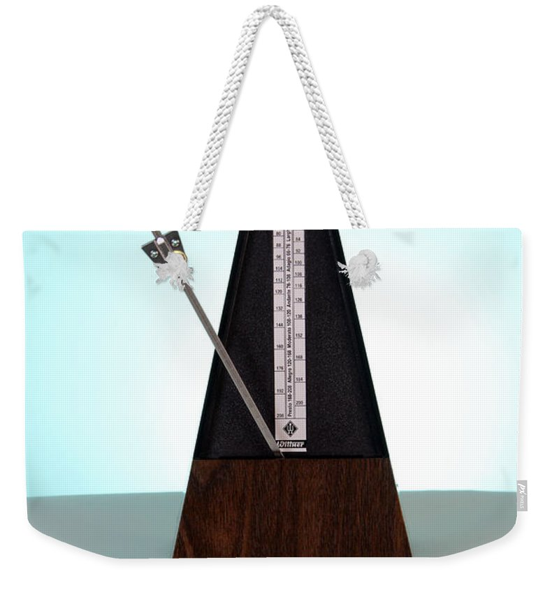 Clockwork Weekender Tote Bag featuring the photograph Metronome by Photo Researchers, Inc.