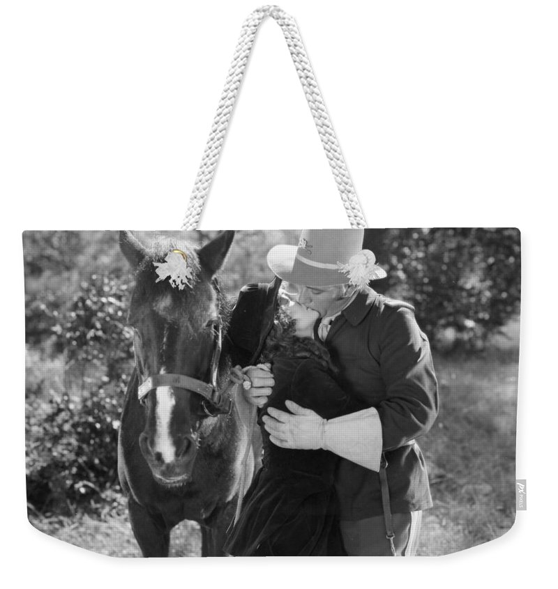 -kissing- Weekender Tote Bag featuring the photograph Silent Film Still by Granger