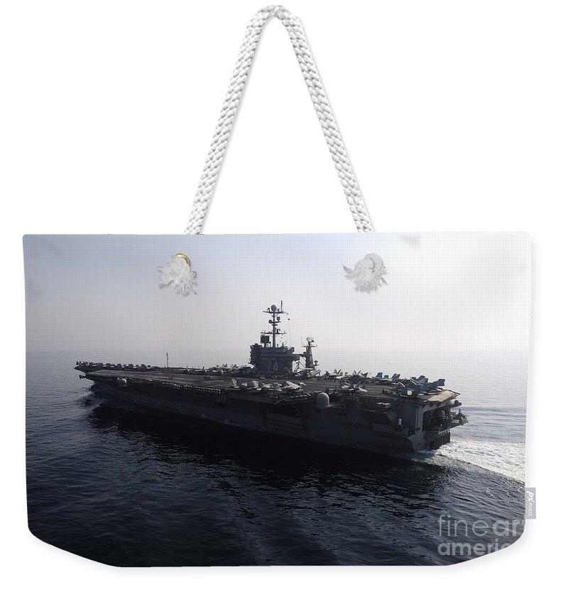 Uss John C Stennis Weekender Tote Bag featuring the photograph The Nimitz-class Aircraft Carrier Uss by Stocktrek Images