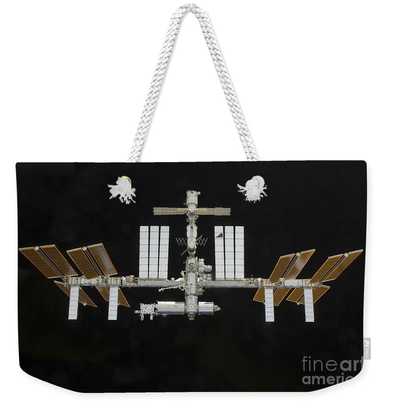Satellites Weekender Tote Bag featuring the photograph International Space Station by Stocktrek Images