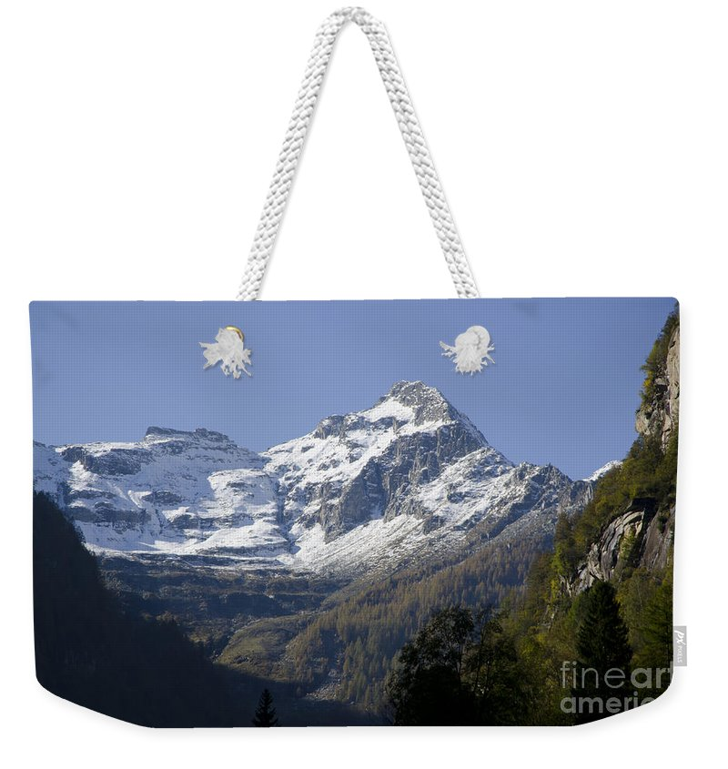 Mountain Weekender Tote Bag featuring the photograph Snow-capped Mountain by Mats Silvan