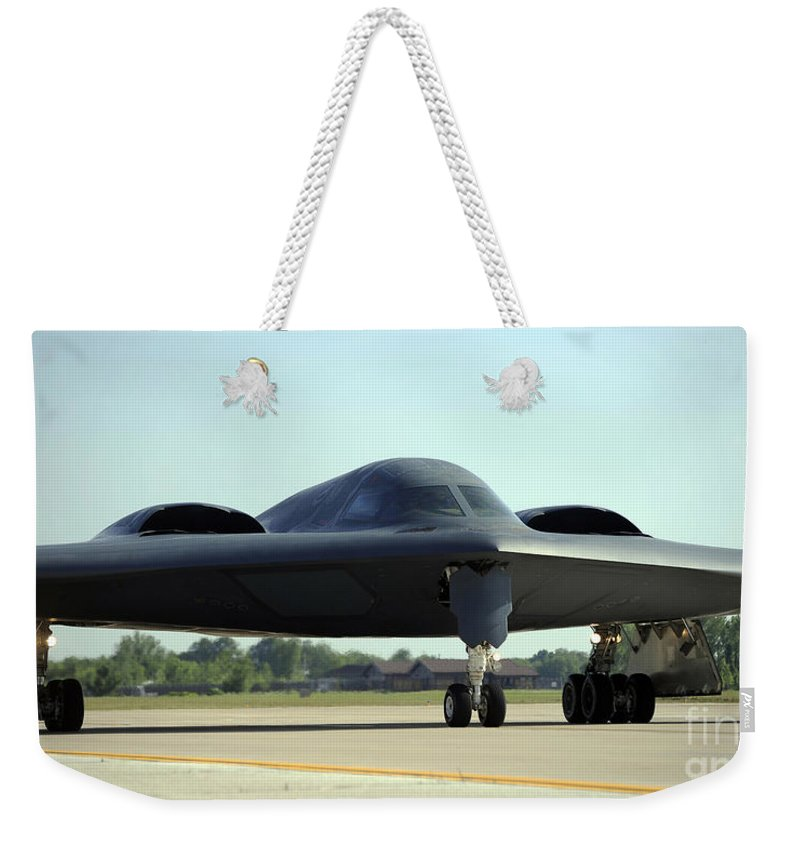 Missouri Weekender Tote Bag featuring the photograph A B-2 Spirit Taxis Onto The Flightline by Stocktrek Images