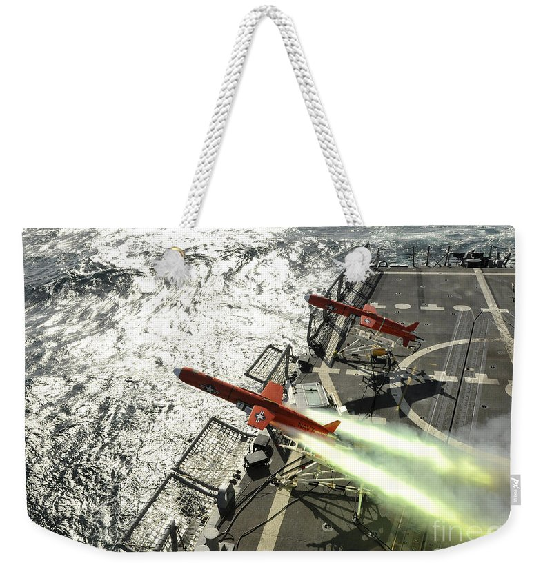 Weapon Weekender Tote Bag featuring the photograph A Bqm-74e Aerial Drone Launches by Stocktrek Images