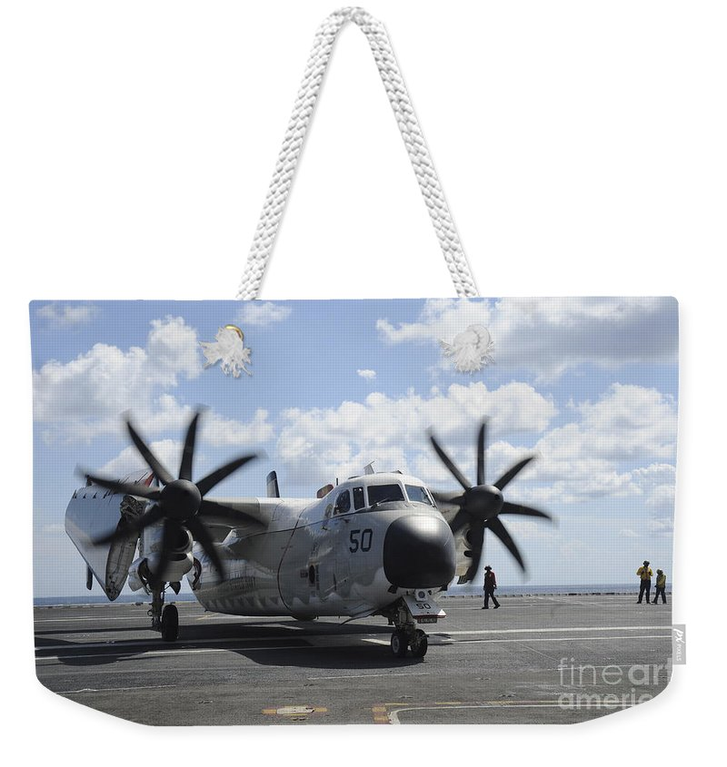 Military Weekender Tote Bag featuring the photograph A C-2a Greyhound Taxis On The Flight by Stocktrek Images