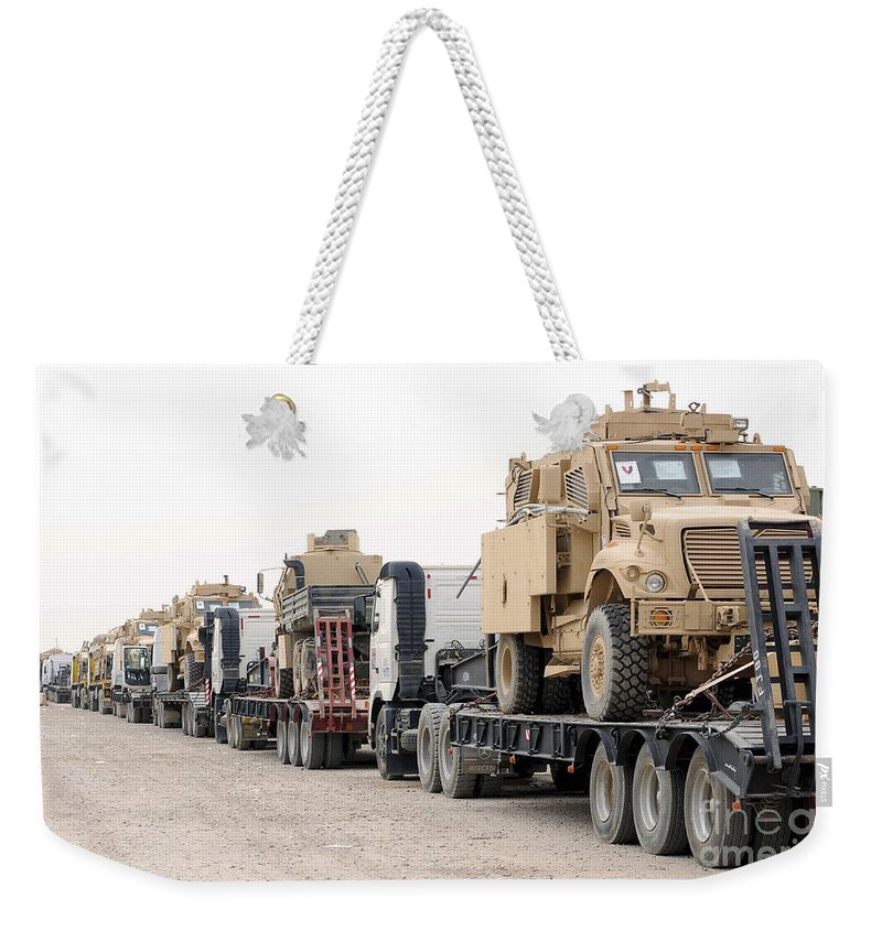 Iraq Weekender Tote Bag featuring the photograph A Convoy Of Mine-resistant Ambush by Stocktrek Images