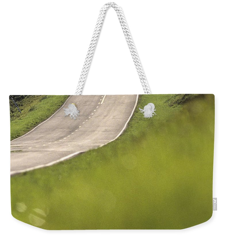 Roads Weekender Tote Bag featuring the photograph A Country Road In Virginia by Kenneth Garrett