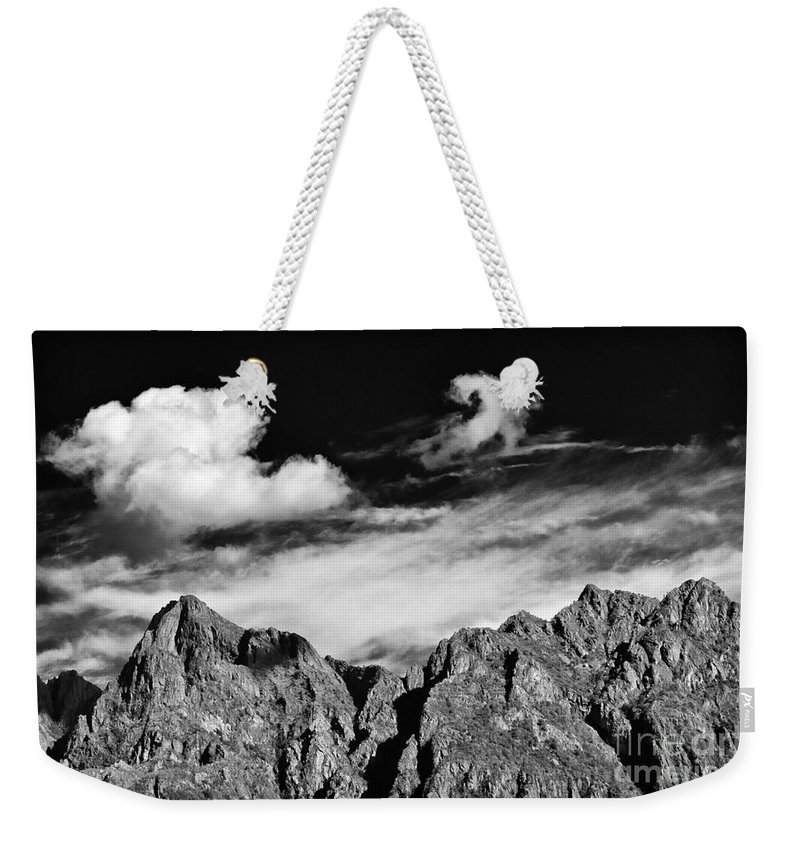 Alps Weekender Tote Bag featuring the photograph A Curl In The Sky by Silvia Ganora