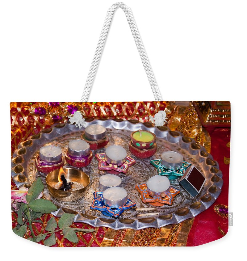 Hindu Weekender Tote Bag featuring the photograph A Decorated Hindu Prayer Thaali With Wax Candles Oil Lamps by Ashish Agarwal