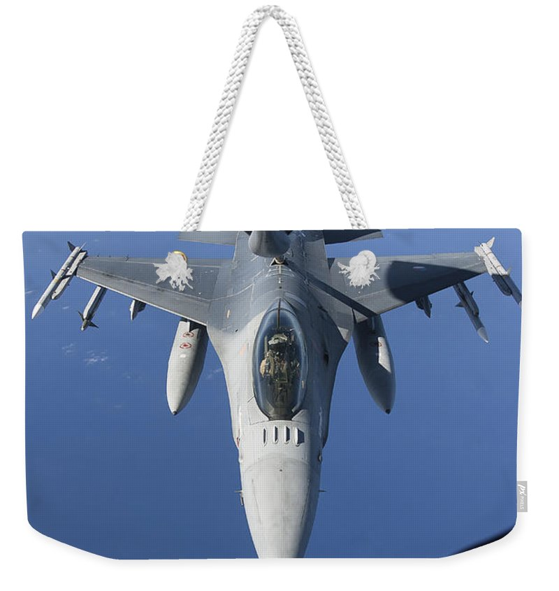 Aim-120 Weekender Tote Bag featuring the photograph A Dutch F-16am Conducts In-flight by Gert Kromhout