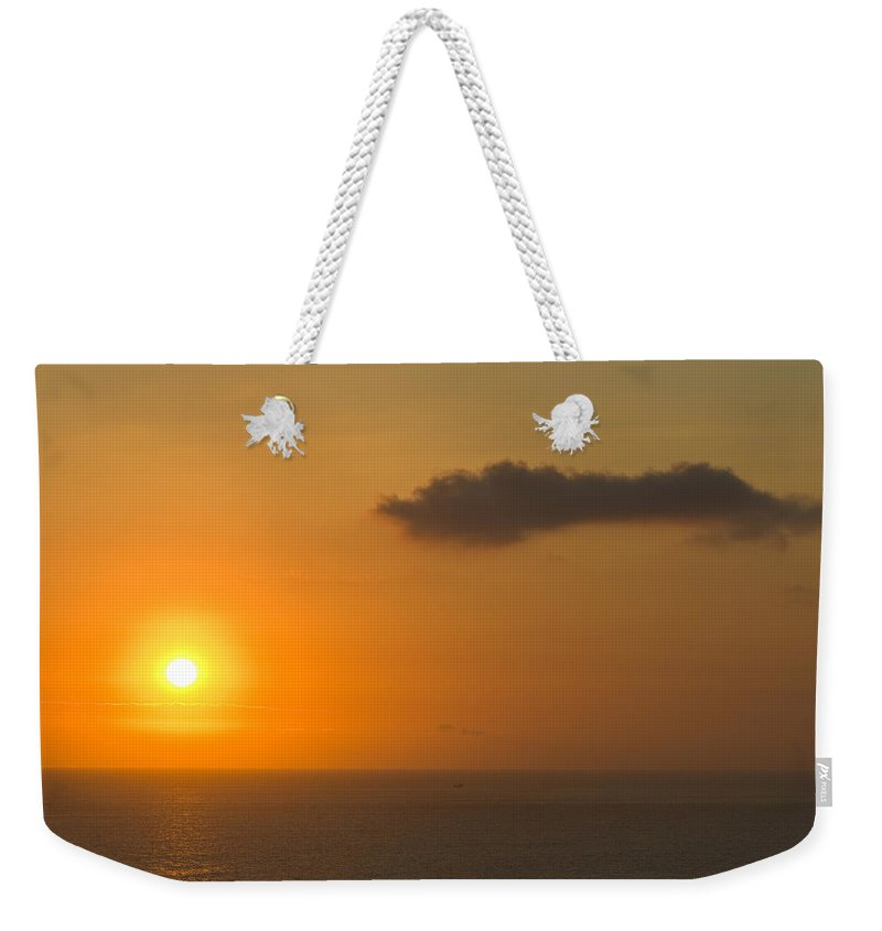Distant Weekender Tote Bag featuring the photograph A Flaming Tropical Island Sunset by Jason Edwards